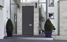 Aluminiowe drzwi wejściowe - wejście na całą wysokość kondygnacji budynku